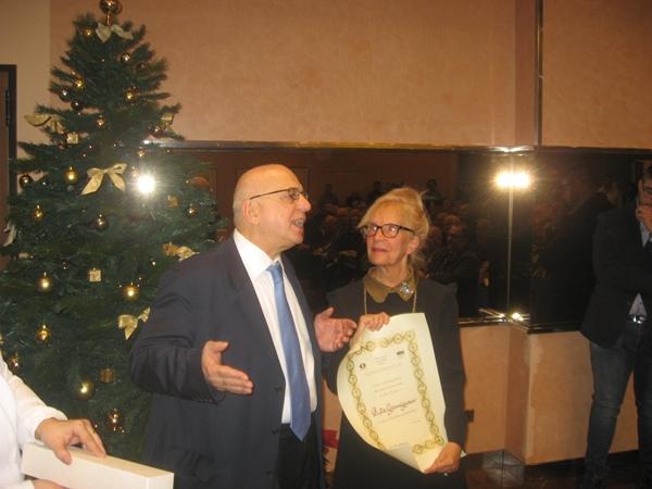 Pagnoncelli conferisce alla nove volte Campionessa Italiana Femminile Rita Gramignani il titolo di Maestro