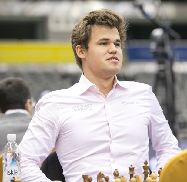 carlsen_dohachess2016_day1_by-emelianova_4y3a5311